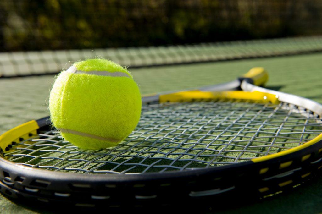 Tennis Equipment on Grass